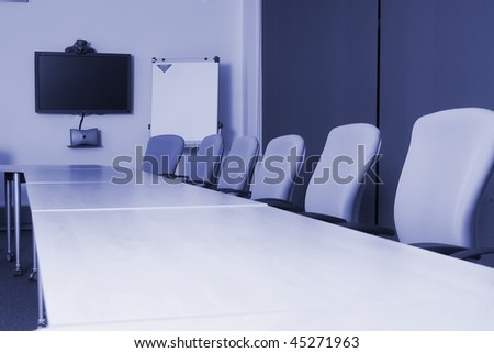 Conference room with video conference equipment and laptop
