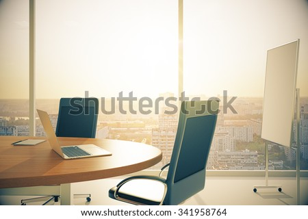Conference room with wooden table with laptop and blackboard at sunset 3D Render
