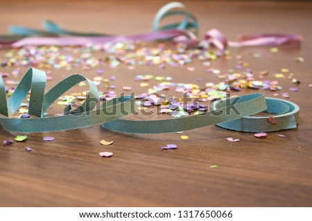 Confetti and serpentine on the floor after brazilian carnival #1317650066