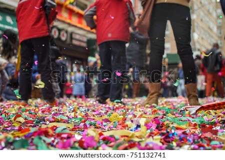 Confetti lines the streets after the Chinese New Year celebration in New York's Chinatown.