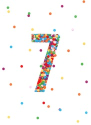 Confetti number. Number seven made from confetti. Color dots. Number decoration card. Confetti under paper