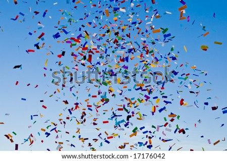 Confetti paper filled colorful blue sky background