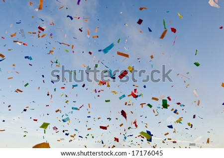 Confetti paper filled colorful blue sky background - stock photo