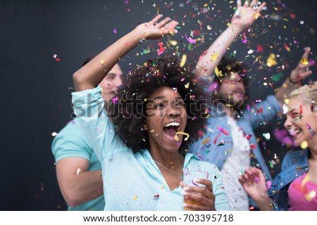 confetti party Multiethnics group of happy young people celebrating new year eve while dancing and have fun at home