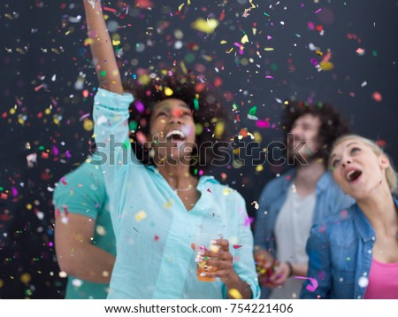 confetti party Multiethnics group of happy young people celebrating new year eve while dancing and have fun at home isolated over gray background