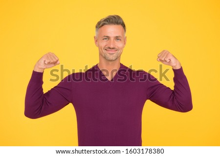 Confidence is best outfit. Confident man yellow background. Handsome guy flex arms. Confident look of fashion model. Fashion and style. Confident and strong. Developing confident power.