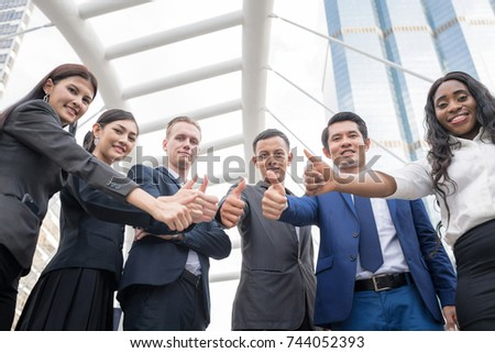 Confident and Active Businesspersons Creative Business Meeting Outdoor.Boss Business Teamwork Showing Thumb Up.Startup Running The New Project Plan.Dealing, Merger and Acquisition Concepts. - Shutterstock ID 744052393