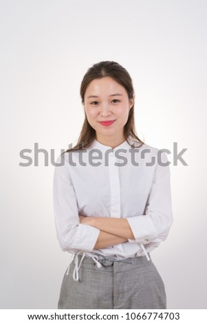 Confident and beautiful young female white-collar workers
