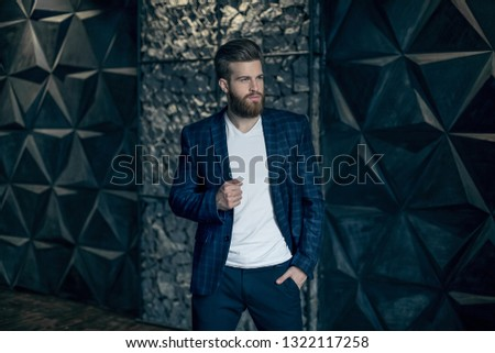 Confident and handsome. Handsome man with long hair and beard looking away while standing against grey background. #1322117258