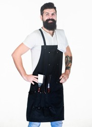 Confident and skillful. Grill master keeping his hands on hips with confidence. Master chef wearing grill apron with barbecue tools. Master of grill. Barbecue master class at grill restaurant.