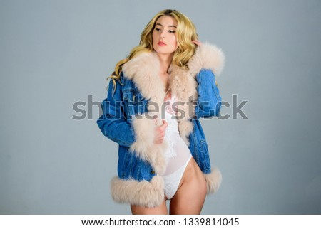 Confident and stylish beauty. Fashion beauty. Sensual girl with fit body. sexy woman in denim style. Sexy woman in erotic lingerie and fur jeans jacket. Blond curly hair. Looking perfect. #1339814045