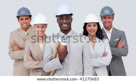 Confident architectural team smiling at the camera