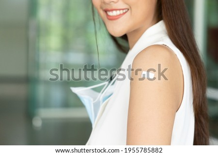 Confident asian woman getting vaccinated immunity via vaccine program, concept of healthy inoculation, vaccination, vaccine for business office worker, vaccinated patient, herd immunity by vaccine