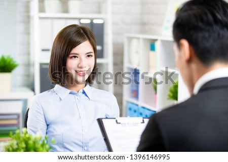 confident asian woman talk to interviewer for a job interview