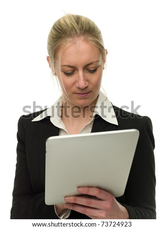 Confident attractive businesswoman isolated over white using tablet computer