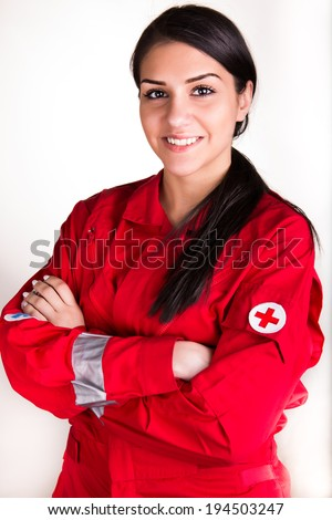 Confident beautiful paramedic woman in uniform with stethoscope on white background