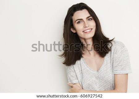 Confident beauty smiling to camera, portrait