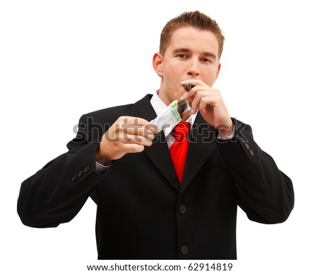 Confident business man lighting a cigar with one hundred euro banknote