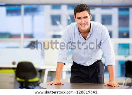 Confident business man smiling at the office