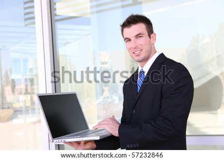 Confident business man working in office on laptop computer