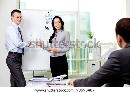 Confident business partners carrying out presentation of business plan to manager