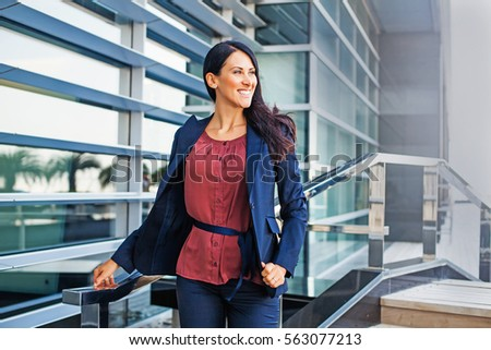 confident business woman walking outdoors