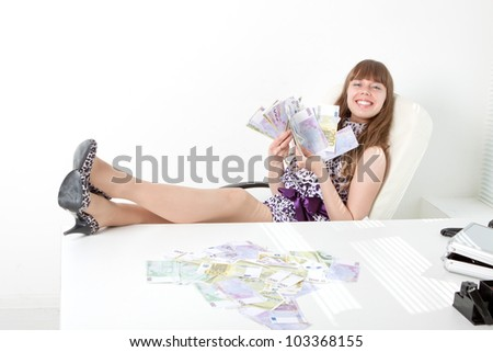 Confident business woman with a lot of money