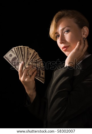 Confident business woman with dollars