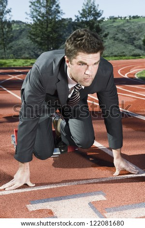Confident businessman are about to run in a race