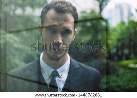 Confident businessman. Confident young man in full suit looking away while standing outdoors. #1446762881