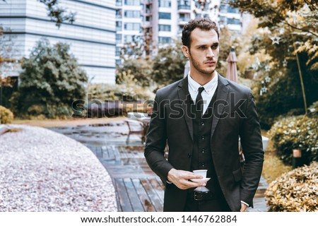 Confident businessman. Confident young man in full suit looking away while standing outdoors. #1446762884