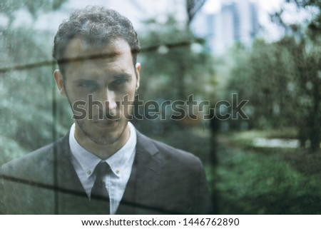 Confident businessman. Confident young man in full suit looking away while standing outdoors. #1446762890