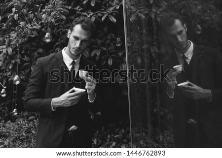 Confident businessman. Confident young man in full suit looking away while standing outdoors. #1446762893