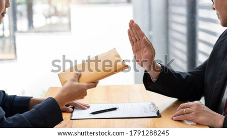 Confident businessman manager rejecting an offer of money to agreement contract from partner or refusing to take bribe, Bribery and corruption concept Сток-фото ©