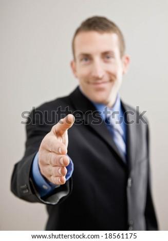 Confident businessman offering hand for handshake
