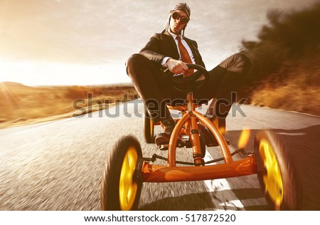 Confident Businessman on Pedal Car