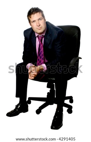 Confident businessman sitting on black corporate leather chair, isolated.