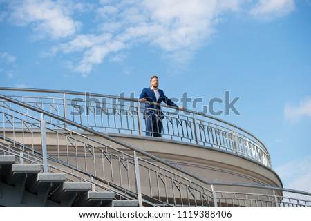 Confident businessman stand on balcony on cloudy blue sky. Man in formal wear outdoor. Looking to the future. Thinking about new possibilities. Confidence and charisma. Male fashion. Best manager ever