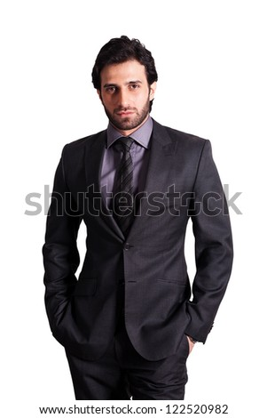 confident businessman standing against isolated white background