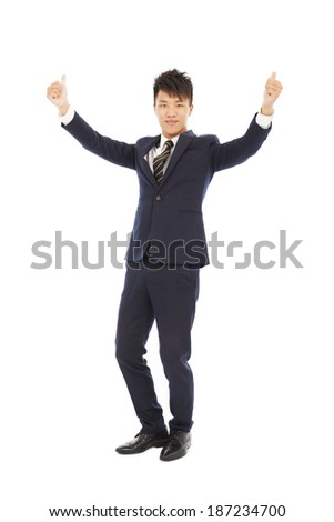 confident businessman standing and thumb up