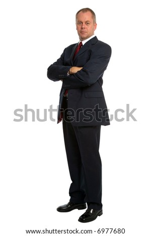 Confident businessman wearing a suit standing with his arms folded.