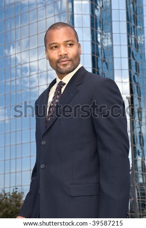 confident businessman with an office building in the background