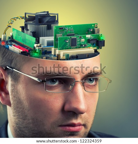 Confident businessman with computer in head