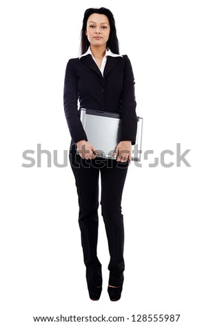 Confident businesswoman holding a laptop in her hands in full length pose isolated on white background. Business concept