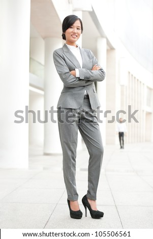 Confident businesswoman standing outside and looking at camera