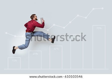 Confident casual man with the beard running up the drawn stairs to reach success
