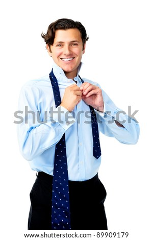 Confident caucasian man is happy while he dresses for work