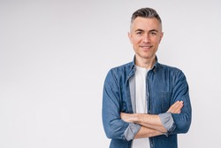 Confident caucasian middle-aged man in casual clothes with his arms crossed isolated over white background