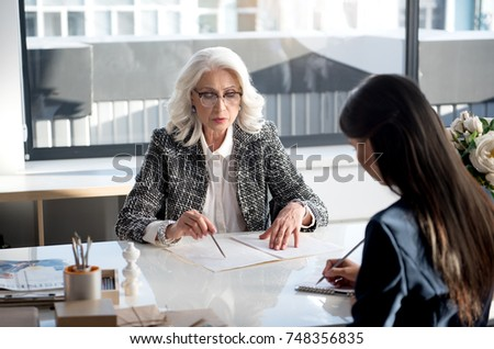 Confident charming women are laboring together in office - Shutterstock ID 748356835
