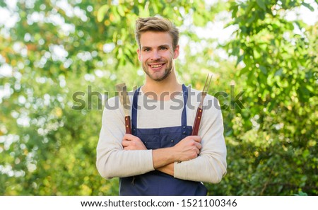confident chef. Culinary concept. Chef cooking bbq food. Tools for roasting meat outdoors. man barbecue grill. picnic cooking utensils. Outdoor party weekend. Family weekend outing. Summer picnic.